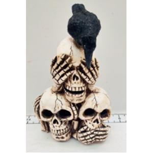 Figura de 3 cráneos con luz led de 15x10x22cm