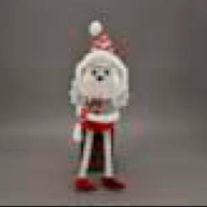 Ave con traje navideño