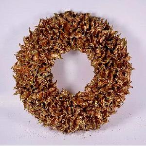 Corona de hojas deshidratadas en dorado c/diamantina de 32x32x7cm