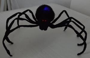 Araña negra con ojos de luz led de10x69x17cm