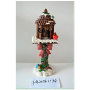 Casita navideña con poste nevado y niños de 20x16x52cm (usa 3 baterias AAA)