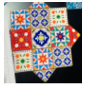 Porta calientes diseño estrella con estampado de mosaicos de colores de 20x20cm