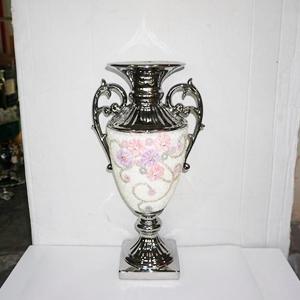 Florero plateado diseño flores con incrustación de pedrería de 25x18x50cm