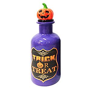 Botella morada con estampado de veneno y tapón diseño calabaza de7x7x19cm