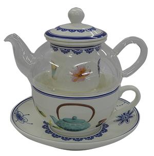 Tetera de cristal con filtro  taza y  plato de porcelana con estampado