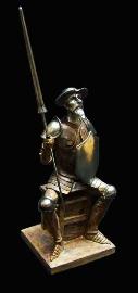 Don Quijote con lanza y escudo sentado