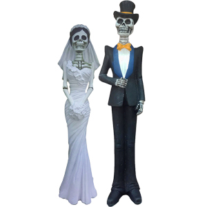 Calavera de resina vestida de novia o con traje de 7x5x32cm