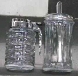 Azucarera de vidrio y metal