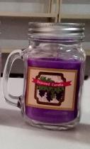 Tarro con vela aroma a uva de 13x7.5cm