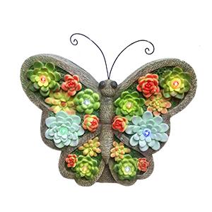 Mariposa de resina con flores y luces led (usa 1 bateria doble A) de 30x9x29cm