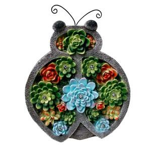 Catarina de resina con flores  y luces led (usa 1 bateria doble A) de 26x9x34cm