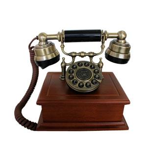 Teléfono vintage dorado en base de madera café