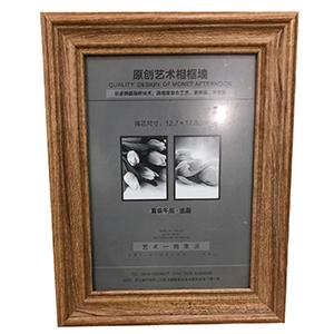 Portarretratos de madera natural de 13x18cm